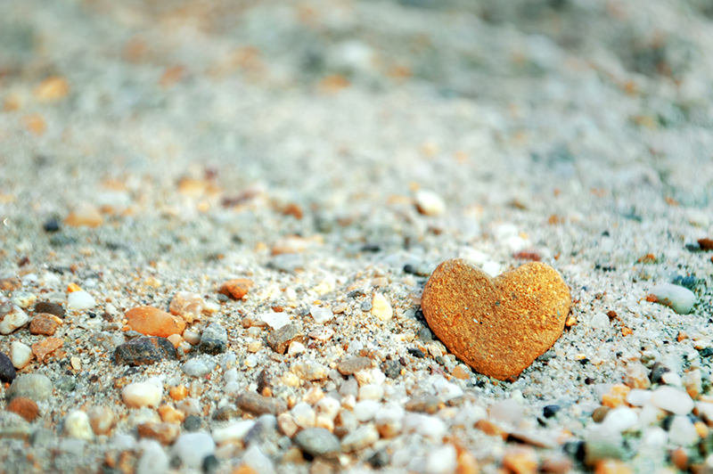 heart rock in sand